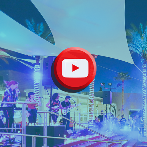 Band on stage with YouTube logo