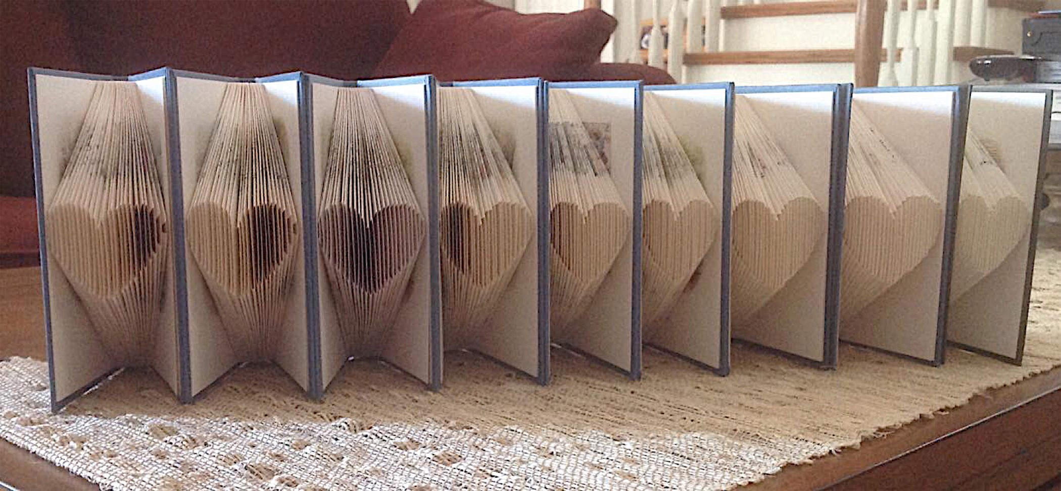 Books with pages folded into hearts